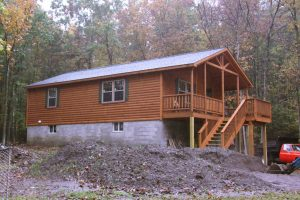 settler log cabin built on concrete foundation