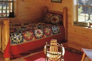 rustic guest bedroom in log cabin
