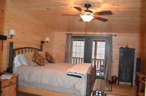 interior bedroom in musketeer log cabin