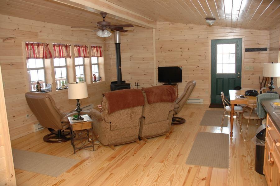 Wooden interior frontier living room cozy cabins llc for Cozy cabins pa