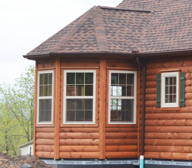 Log cabin with window bump-out