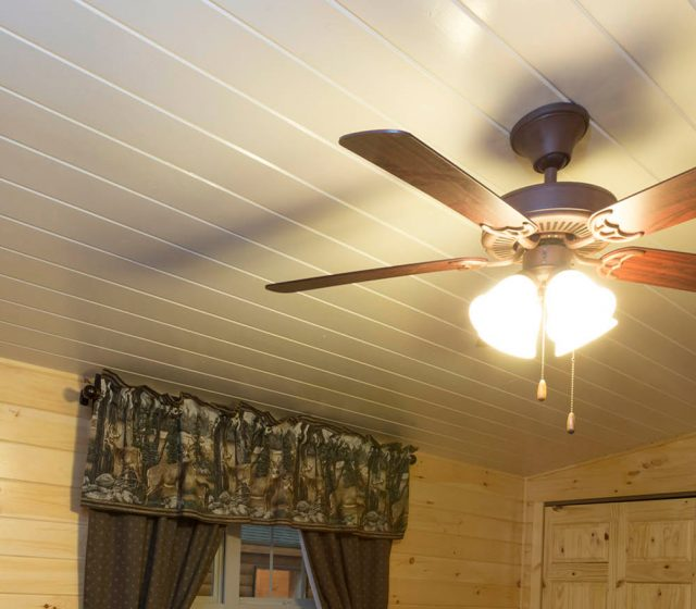 log cabin interior with ceiling fan