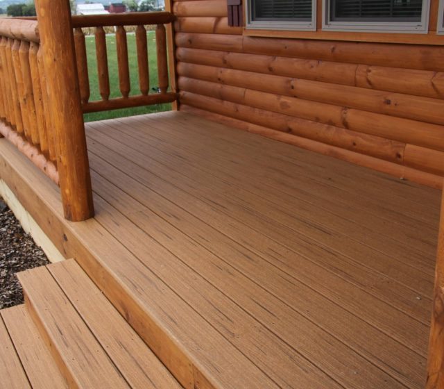log cabin with wood decking