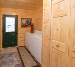 laundry room in modular log home
