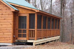 Log cabin with screened in porch