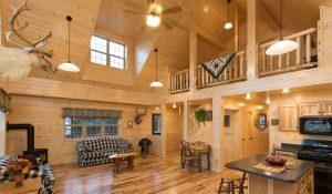 modular log cabin with high vaulted ceiling