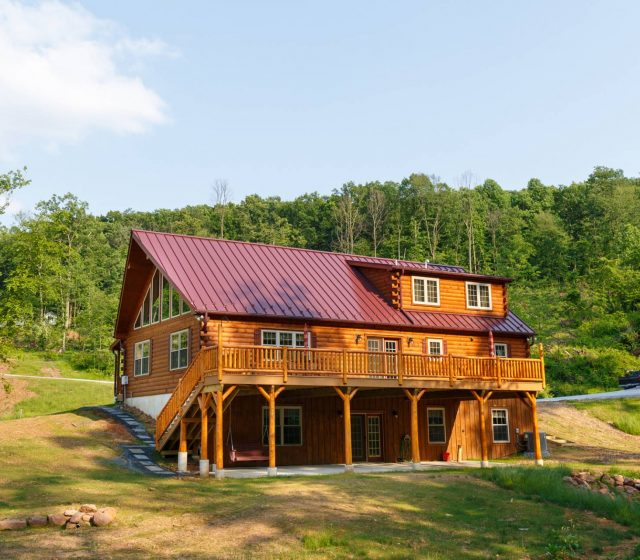 chesnut brown log home with two story porch