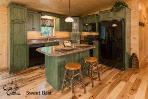 maple sweet basil cabinets in log cabin kitchen