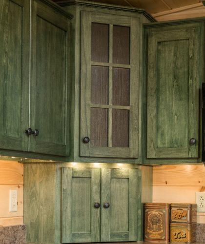 glass door on wooden kitchen cabinet