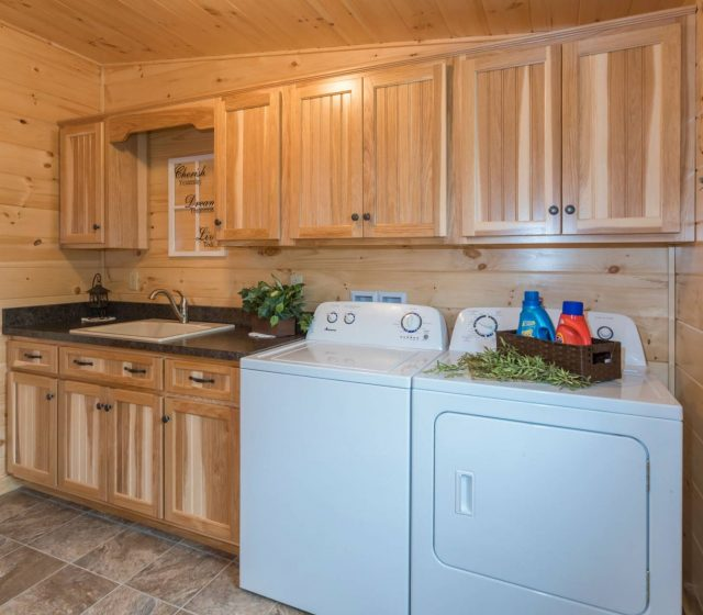 hickory wooden cabinets over laundry machine