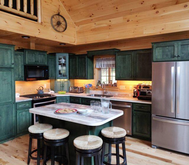 dark green cabin kitchen cabinets