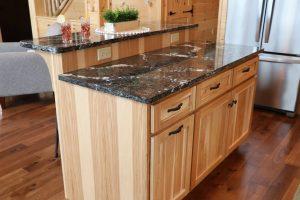 black quartz tiered kitchen island
