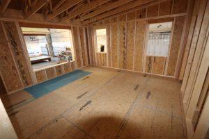 interior of log cabin living room during modular construction