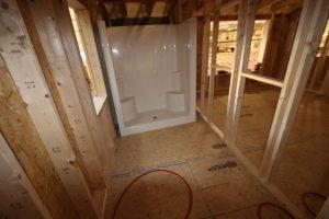 wooden construction of log cabin bathroom