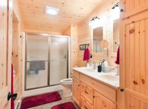 white pine cabin bathroom with sliding glass shower