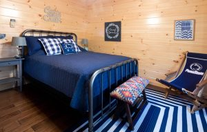 cabin bedroom with queen sized bed