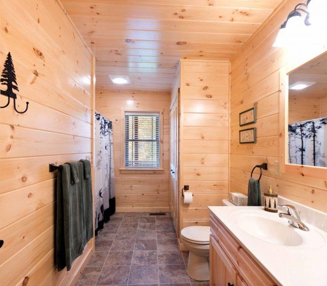 large master bedroom in modular log cabin