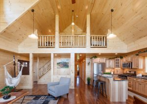 two story modular log cabin with white pine