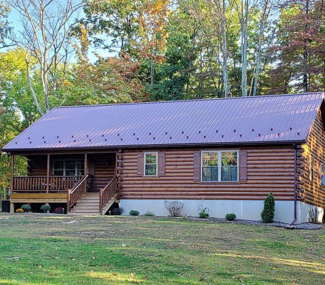 metal roof on ranch modular log cabin