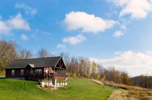new log cabin built on hill