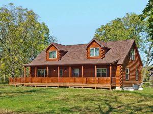 medium sized log cabin with asphalt shingle roof