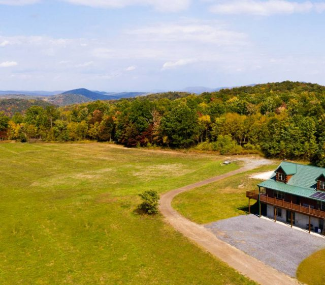 aerial view of cape cod style log home