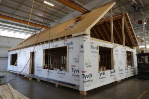 prefab cabin being built in pa warehouse