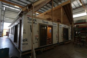 roof being placed on modular cabin