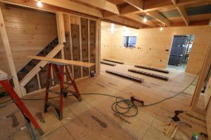 construction of large living area in log cabin