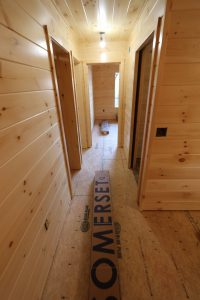 small hallway in modular log cabin