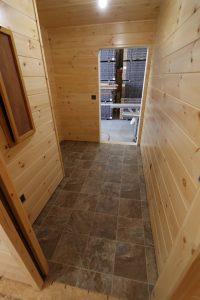 tile floor in modular log cabin