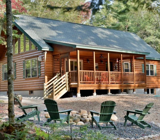 attached porch with overhang on log cabin