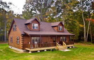 cape cod log home with attached front porch