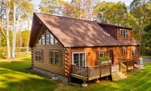 two story cabin with attached deck