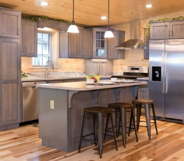 custom log cabin kitchen with gray wooden cabinets