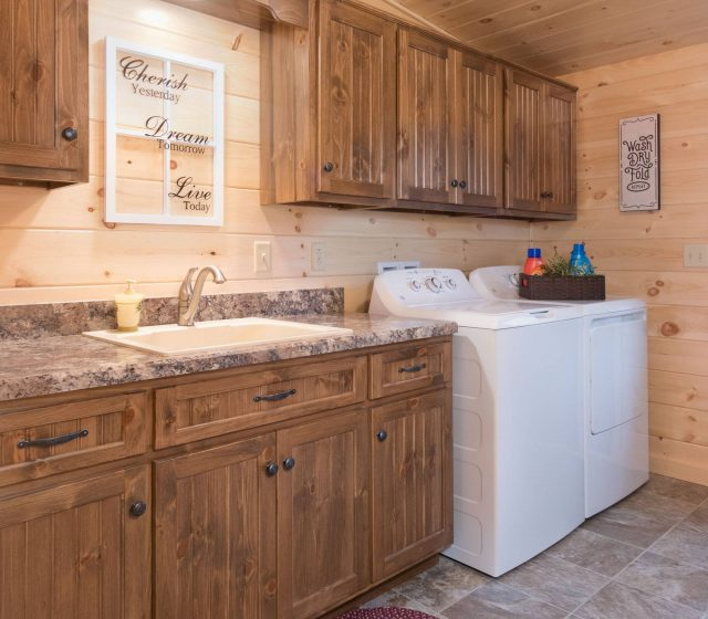 log cabin laundry room with wooden cabinets and new countertop