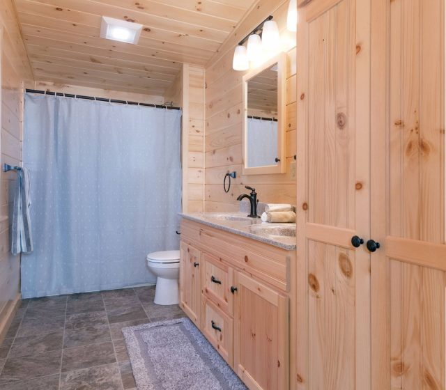white pine cabin drawers and pantry in bathroom
